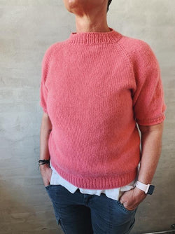 Easy Peasy Raglan Sweater, a beginner-friendly knitting project, in sustainable yarn