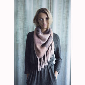 Model wearing Ghita knitted scarf designed by Helga Isager, knitted in Isager Tvinni, Highland Wool and Silk Mohair yarn