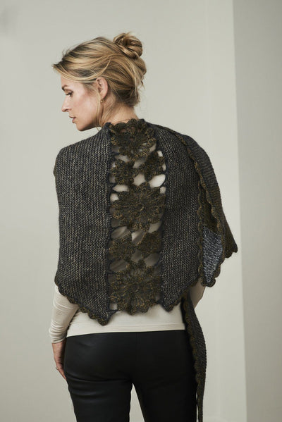 Lenes shawl, a knitted shawl with a flower panel at the back, made in black Isager Highland wool and Silk Mohair