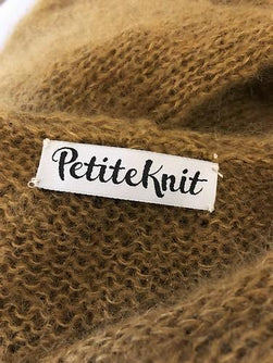 "PetiteKnit Label with the text ""PetiteKnit"" so sew in the neckline of your knitted sweater"