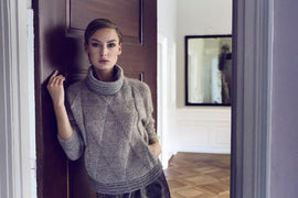 Model wearing Siberia knitted anorak designed by Helga Isager, knitted in Isager Silk Mohair and Jensen yarn.