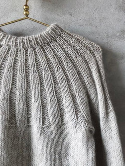 Sunday sweater by PetiteKnit, knitted in light beige Önling No 1 sustainable yarn made of merino wool and angora