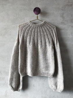 Sunday sweater designed by PetiteKnit, knitted in light beige Önling No 1 sustainable yarn made of merino wool and angora