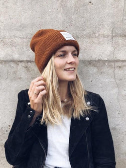 The Oslo Hat by Petiteknit, brown knitted hat, shown on model