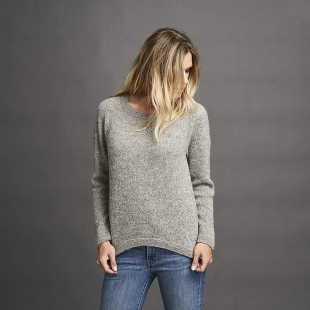 Dagmar classic, knitted grey sweater with braids at the sides, made in Isager alpaca and spinni wool, the front