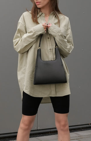 Tess Pelka wearing Jiyo Black Bag, Jeenaa Bags