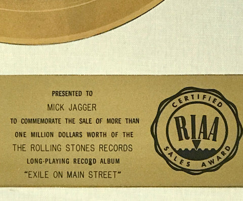 White matte RIAA award presented to Mick Jagger of the Rolling Stones