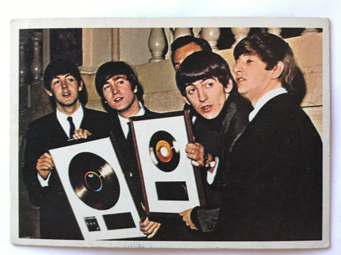 Beatles with RIAA Gold Records on collector card