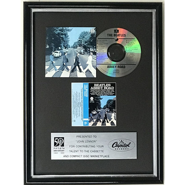 Beatles Abbey Road Capitol Records in-house award presented to John Lennon