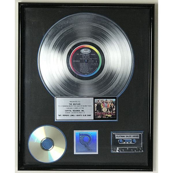 Beatles Sgt. Peppers Lonely Hearts Club Band RIAA Platinum LP Award presented to the Beatles - RARE
