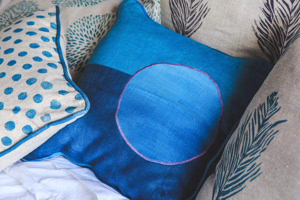 collection of blue pillows|Tulusa