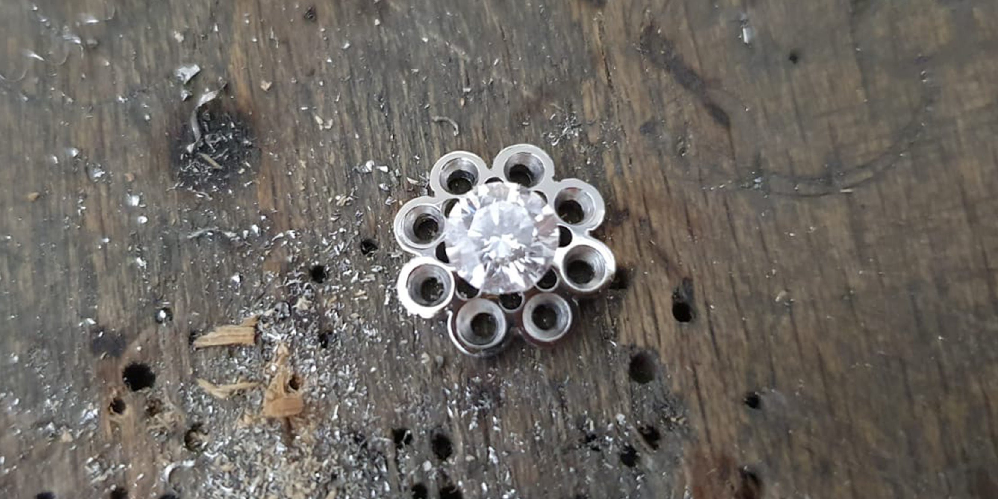 Platinum head for bespoke cluster ring cut out by Amanda Mansell