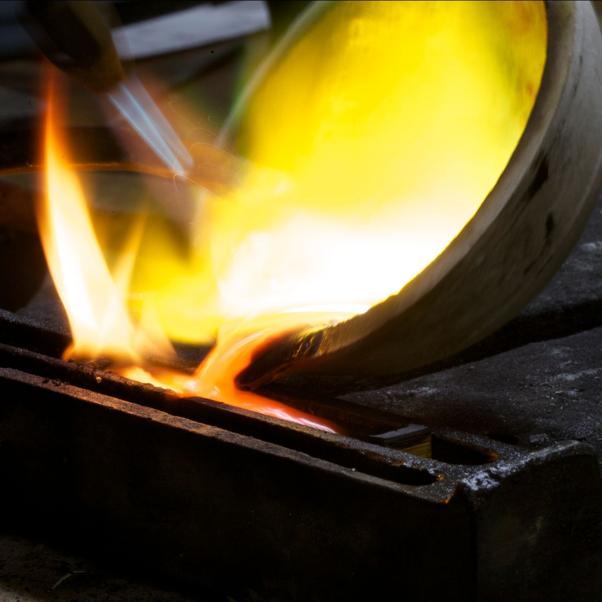 Melting gold and pouring into ingot mould.