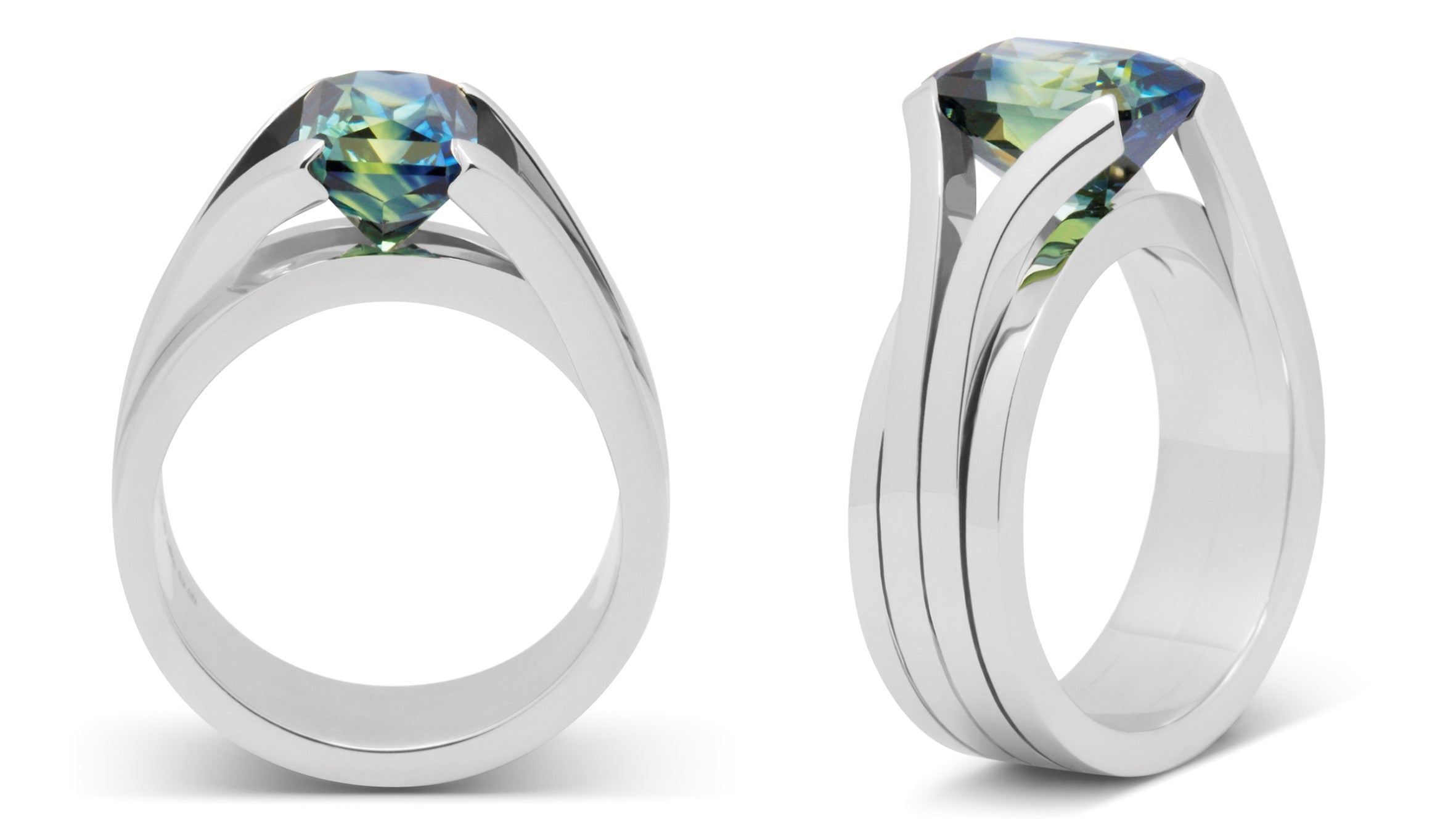 Bespoke platinum and blue green sapphire engagement ring design and made for Matt, by Amanda Mansell