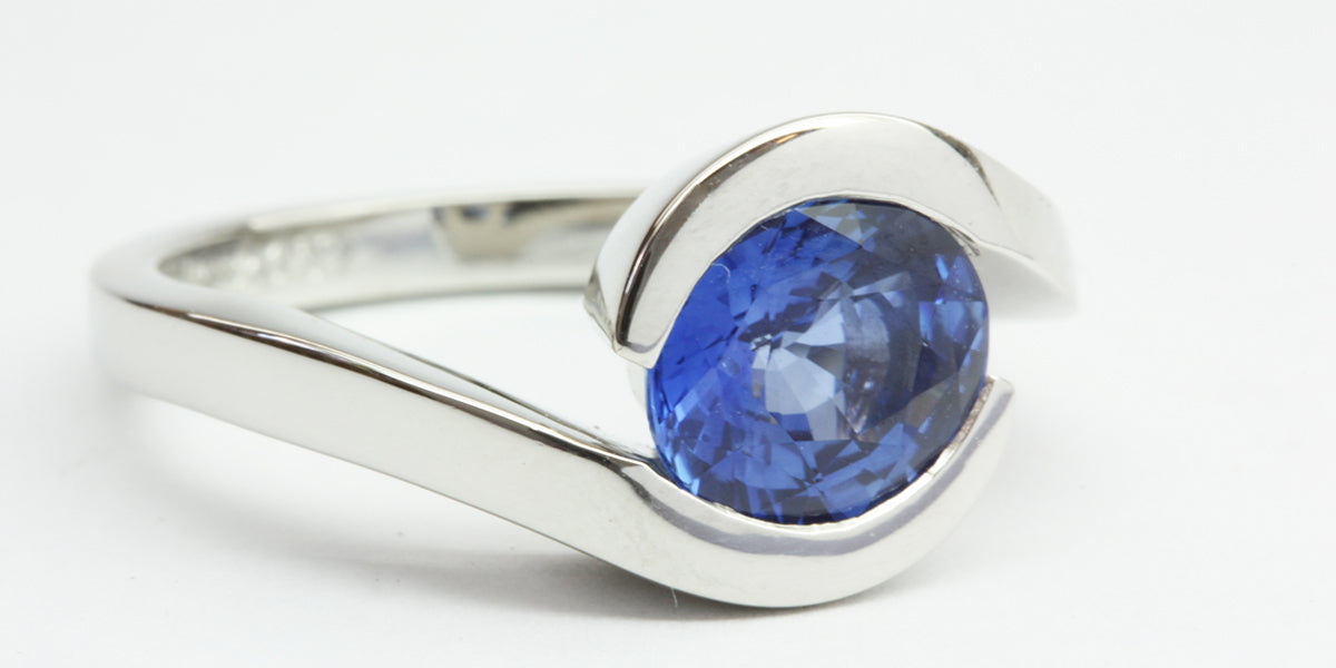 Platinum and blue sapphire engagement ring