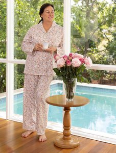 "The ""Armour"" floral print cotton pyjama set is perfect for those relaxed moments at home.  Featuring self piping with long sleeves.  The pyjama pants feature an elasticised waist and drawstring to ensure comfort alongside feminine elegance."