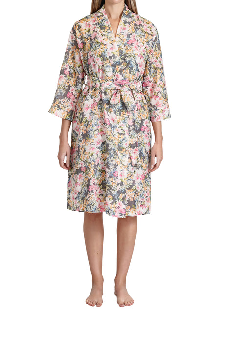 Ava cotton silk robe with a pink floral design, side pockets, tie belt to waist and below the knee in length. Front