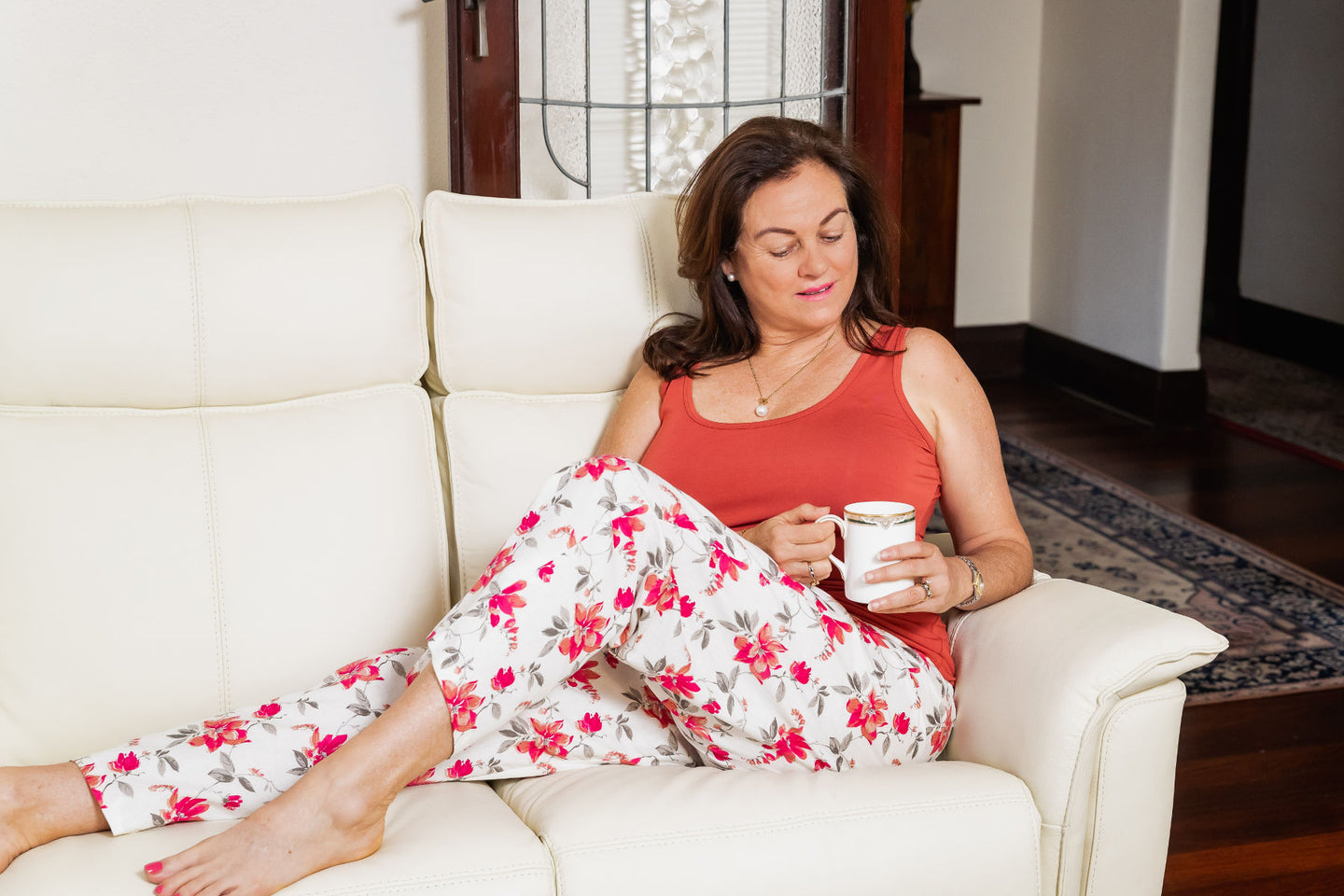 The Rheta floral cotton pyjama pants are full length and made with an elastic soft waist and drawstring.  The pants are perfect for lounging around the house and sleeping in.  The bamboo burnt orange singlet goes perfectly with the pyjama pants to make a set.