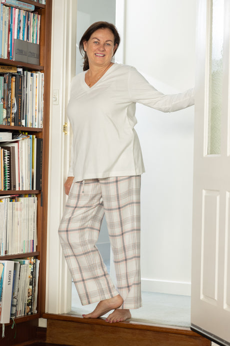 The Daphne cotton pyjama pants feature a beautiful check design with soft elastic to the waist with a drawstring tie.  The pants are comfortable, soft and luxurious to wear.  Perfect for that long breakfast on a Sunday morning.  Combine with the White or Cream V neck long sleeve T-shirt for that overall style.