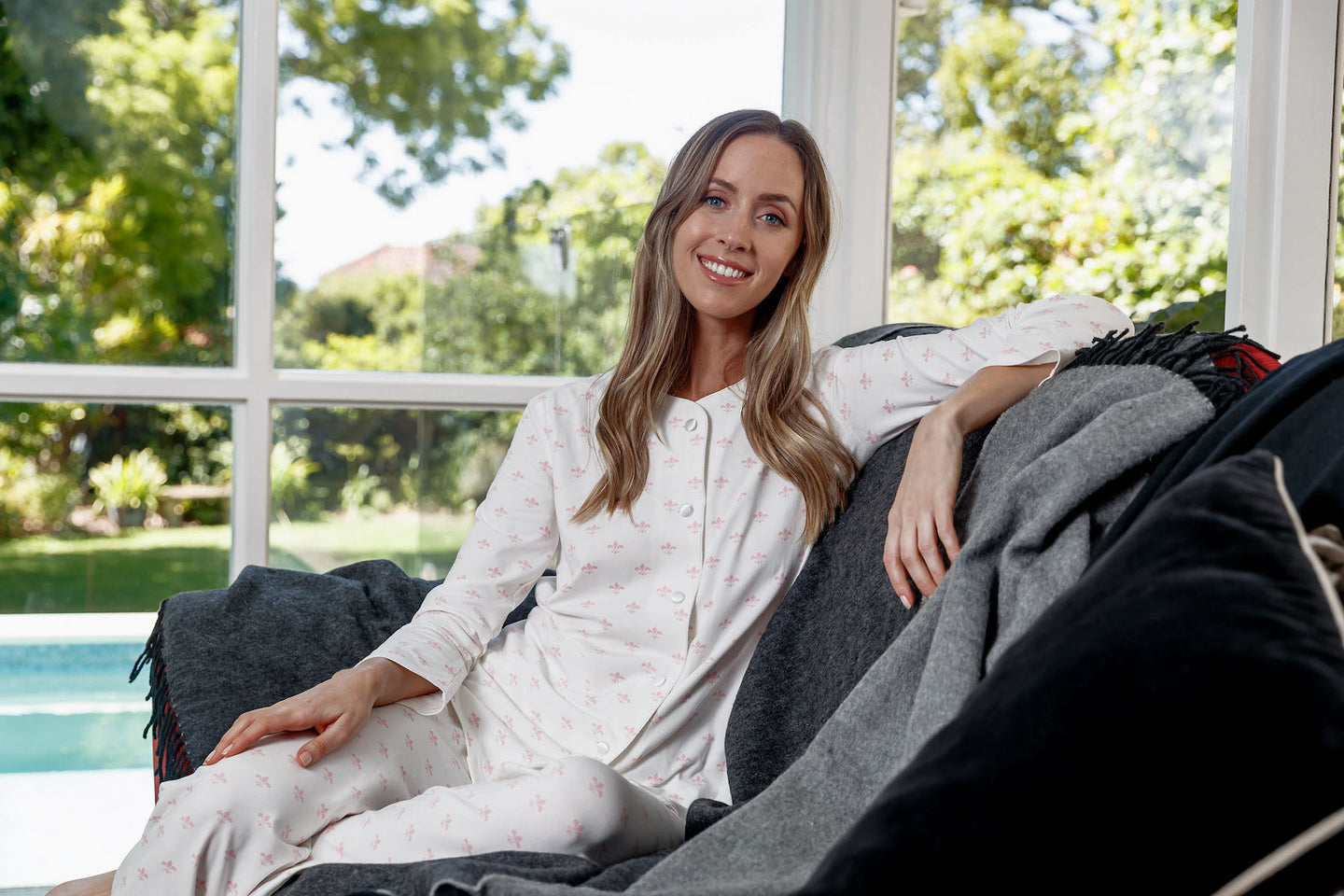 Feel beautiful in the Fleur-de-Lis cotton knit pyjama set with a delicate print on a soft cream background.  The cotton knit long sleeve pyjamas have cream satin piping and covered satin buttons.  The pants are long with a soft elastic waist for comfort.