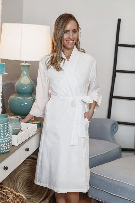 Hail spot white cotton dressing gown/robe with side pockets and tie belt to waist and 3/4 sleeve.  Sits just below the knee.
