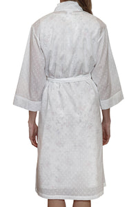 Hail spot white cotton robe with side pockets and tie belt to waist and 3/4 sleeve.  Sits just below the knee. back