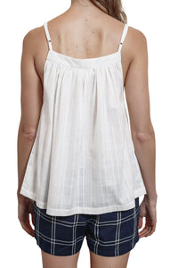The Baby Doll Camisole is white and made from a cotton jacquard fabric with adjustable straps. back