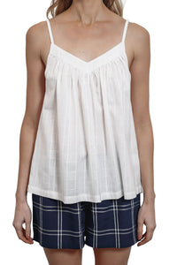 The Baby Doll Camisole is white and made from a cotton jacquard fabric with adjustable straps. front