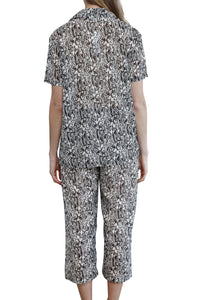 Imogen cotton silk pyjama set with black and white floral design, has 3/4 length elasticised drawstring pants with a short sleeve pyjama top with buttons down the front. back