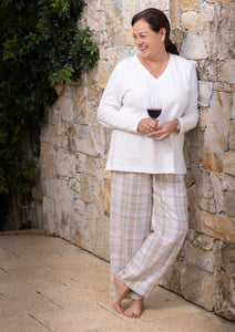 The Kiara cotton pyjama pants feature a beautiful check design with soft elastic to the waist with a drawstring tie.  The pants are comfortable, soft and luxurious to wear.  Perfect for that long breakfast on a Sunday morning.  Combine with the White or Cream V neck long sleeve T-shirt for that overall style.