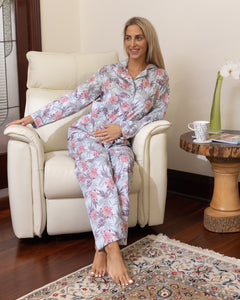 "The beautiful ""Lizzie"" hibiscus print cotton pyjama set is perfect for those coveted moments of relaxation.  Featuring contrasting piping and a classic long sleeve design.  The pyjama pants feature an elasticised waist and drawstring to ensure unrivalled comfort alongside feminine elegance."