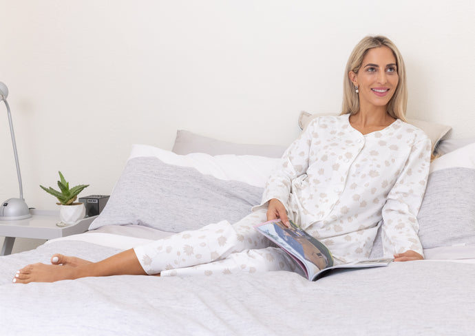 The Matilda soft cotton knit pyjama set features a beautiful Australian design print using the Australian Bridal Flower for inspiration, with soft tones of cream to add feminine touches.  The cotton knit long sleeve pyjamas have cream satin piping and covered satin buttons.  The pants are long with a soft elastic waist for comfort.