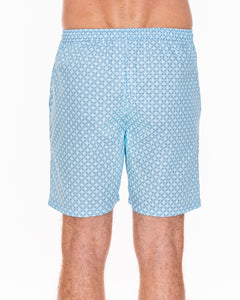 Our light-blue patterned men's pyjama shorts are crafted from 100% cotton.  Lightweight and breathable, they feature a fully elasticated waist and a drawstring made from self-fabric, two side pockets and a concealed fly. Back view.