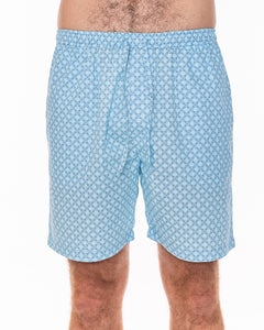 Our light-blue patterned men's pyjama shorts are crafted from 100% cotton.  Lightweight and breathable, they feature a fully elasticated waist and a drawstring made from self-fabric, two side pockets and a concealed fly. Front view.