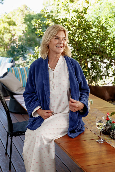 Our navy shawl Collar Bed Jacket is cosy, soft and warm to wear, with a single button for closing, two front pockets, and sits at hip length.