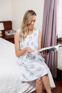 The Stella Cotton Sleeveless Nightie is in a beautiful blue floral pattern with a pleated bodice trim and front button opening with wide shoulder straps and sitting just below the knee.  This nightie is relaxed and comfortable to wear.
