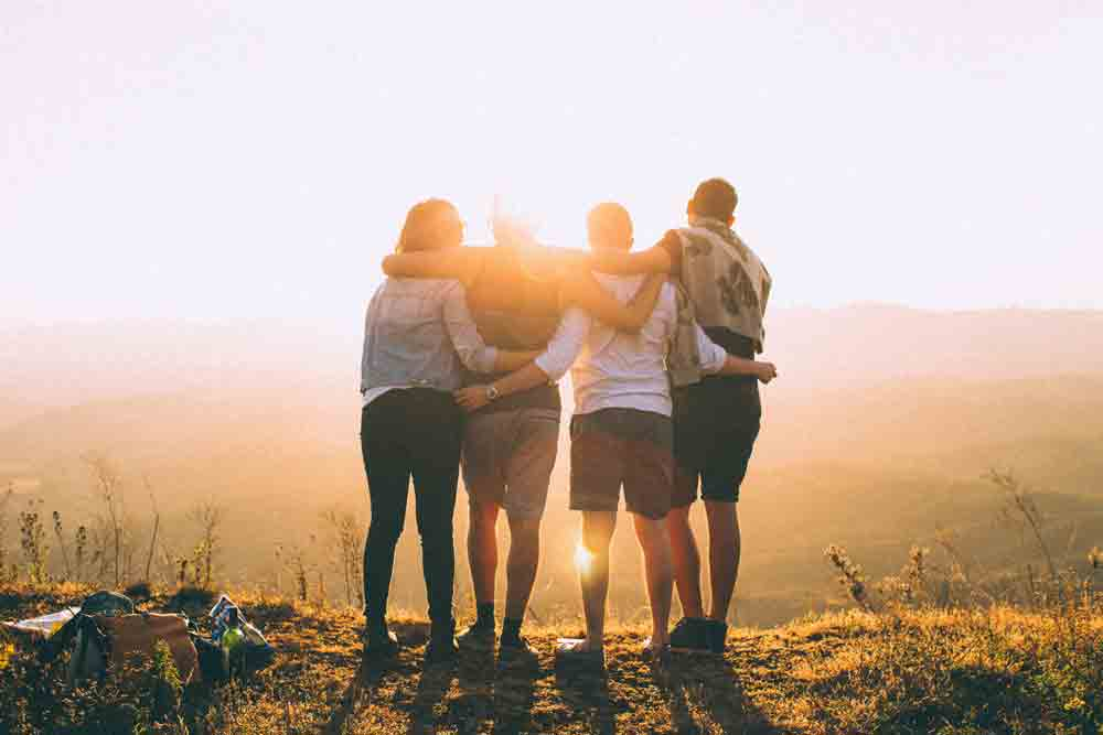 group-people-holding-sunset