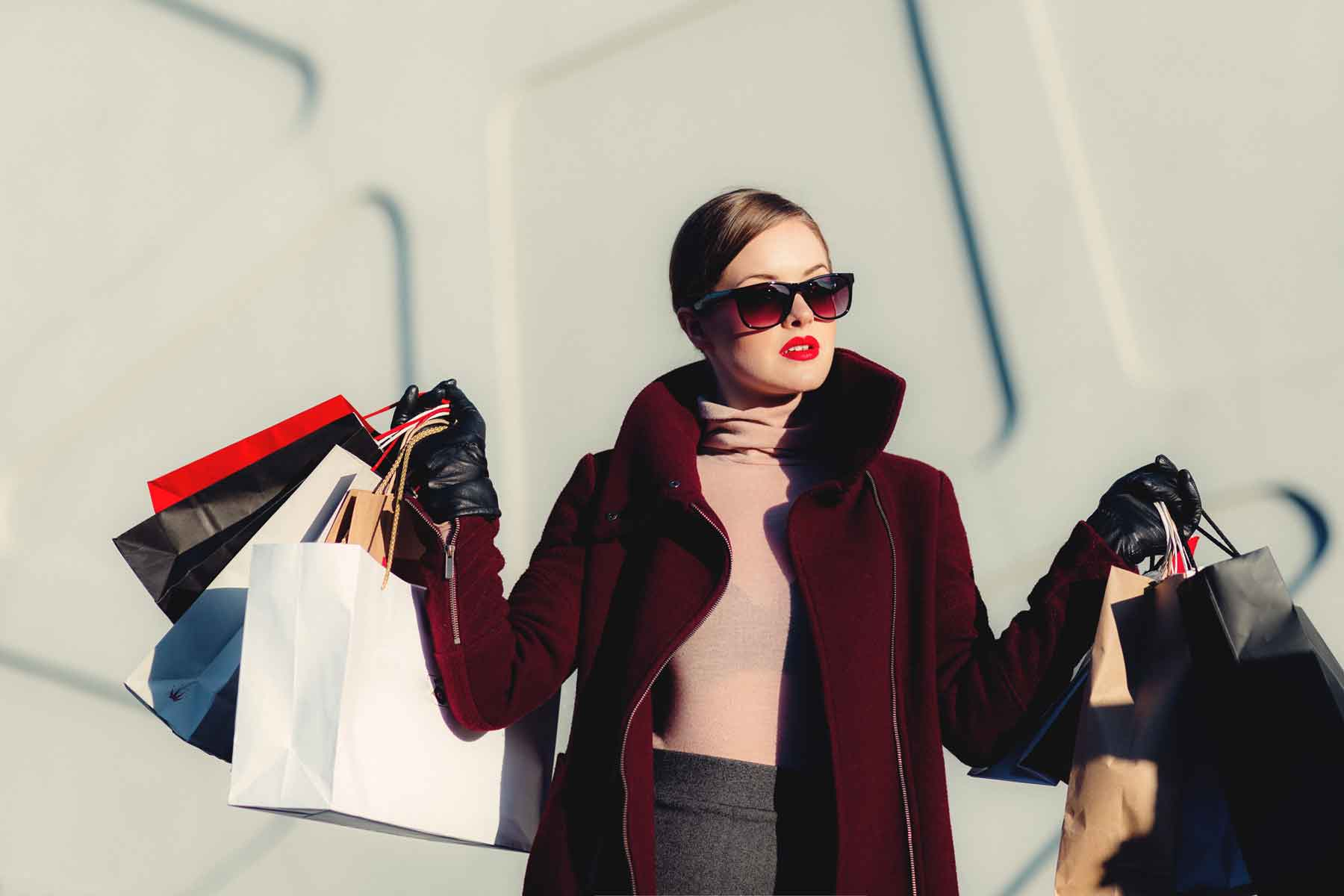 Woman with shopping bags wearing sunglasses