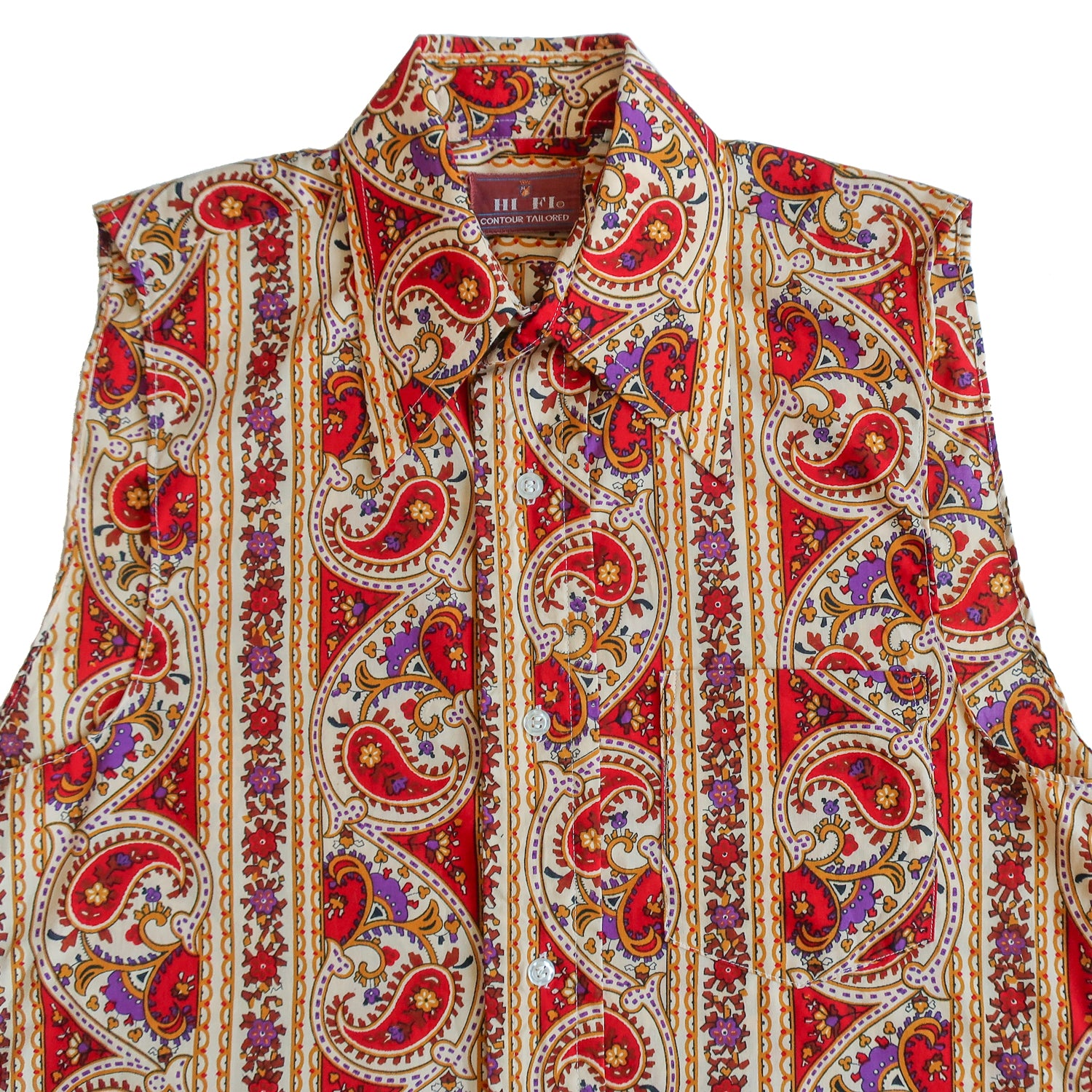 Second Room Vintage Clothing. Vintage 70s red, yellow and purple paisley print sleeveless button up shirt. This blouse has one breast pocket, and an exaggerated pointed collar, which has a stiffener inside, so it always looks sharp. Free Shipping on all orders within North America.