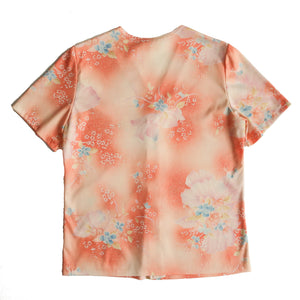 Second Room Vintage Clothing. Vintage 70s peach blouse with floral pattern in pink, yellow and blue. Stretchy with a button front. Free Shipping on all orders within North America.