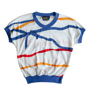 Second Room Vintage Clothing. Vintage white ringer style t-shirt with blue trim on the v-neck, sleeves and bottom, with super cute screen printed ribbon and bow design in yellow, blue and red. Free Shipping on all orders within North America.