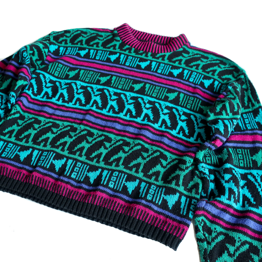 Second Room Shop Vintage. Shop vintage, shop sustainable. Vintage sweater with amazing colourful 90s pattern. Slightly cropped fit, with ribbed bottom and cuffs.