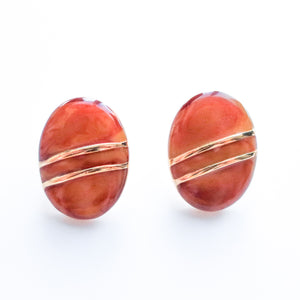 "Second Room Vintage Clothing. Vintage amber and gold tone oval earrings with gold stripes. Earrings are 3/4"" wide and 1-1/8"" tall. Original earring backs have been replaced with new, clear silicone backings. Free North American shipping on all orders."