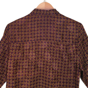Second Room Shop Vintage. Shop vintage, shop sustainable. Nothing says Canadian like The Bay! Vintage long sleeve button up blouse with lovely burgundy and gold medallion pattern. Two front chest pockets with button flap closures.