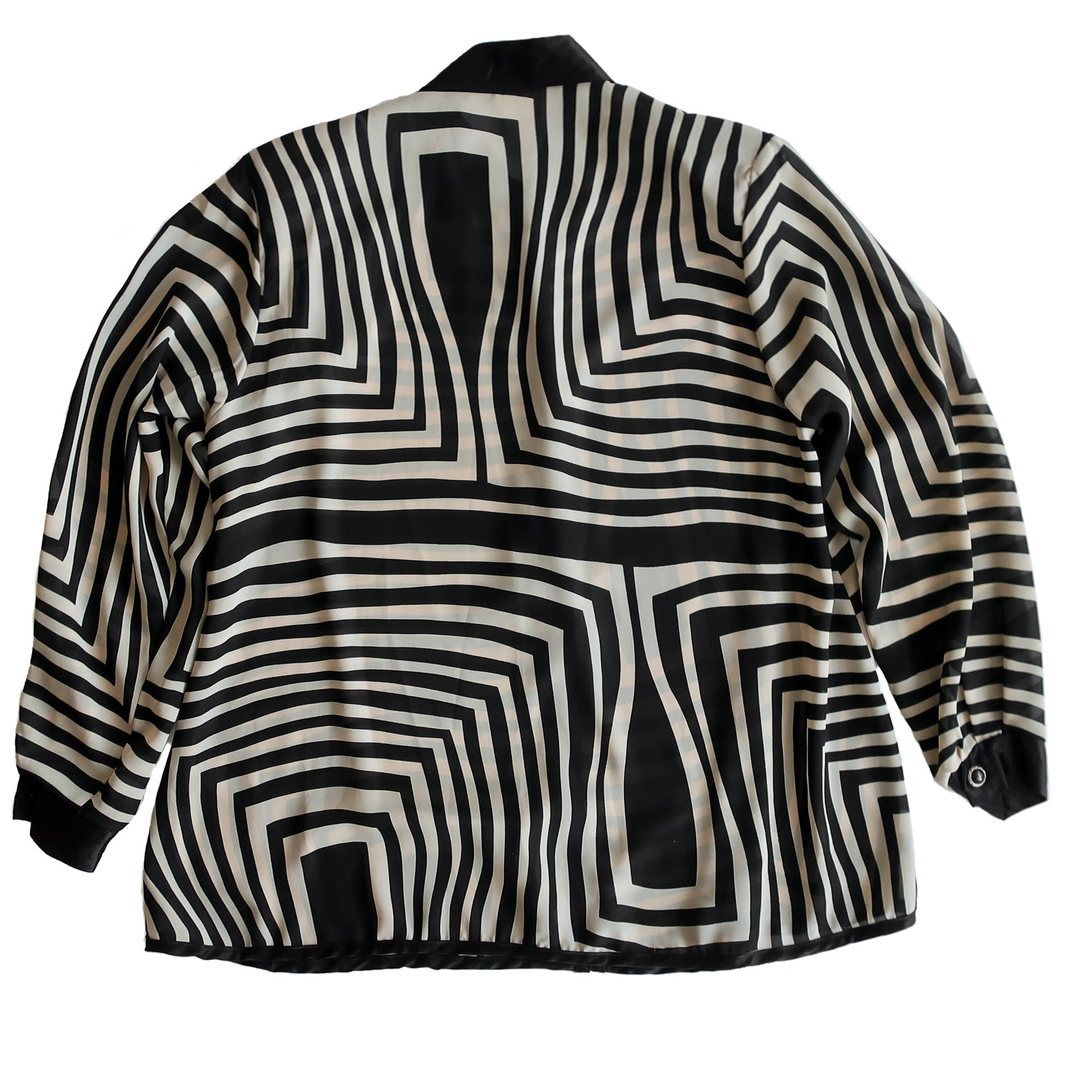 "Second Room Shop Vintage. Shop vintage, shop sustainable. Vintage long sleeve tunic style blouse, semi sheer, with beige and black striped patterns. Black satin trim on collar, front, and cuffs, and has silver and black buttons that go 20"" down the front; the bottom portion of the top is open. Has shoulder pads, but they can easily be snipped out, and one button on each cuff."