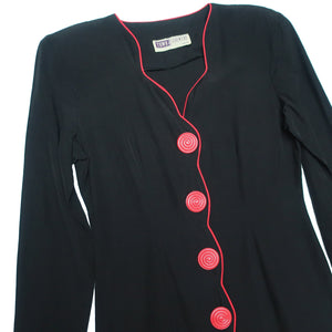 Second Room Vintage Clothing. Vintage long sleeve black button up dress with oversize red plastic buttons, and scallop detail with red piping. It is unlined, with shoulder pads that could be easily removed if desired. Free North American shipping on all orders.