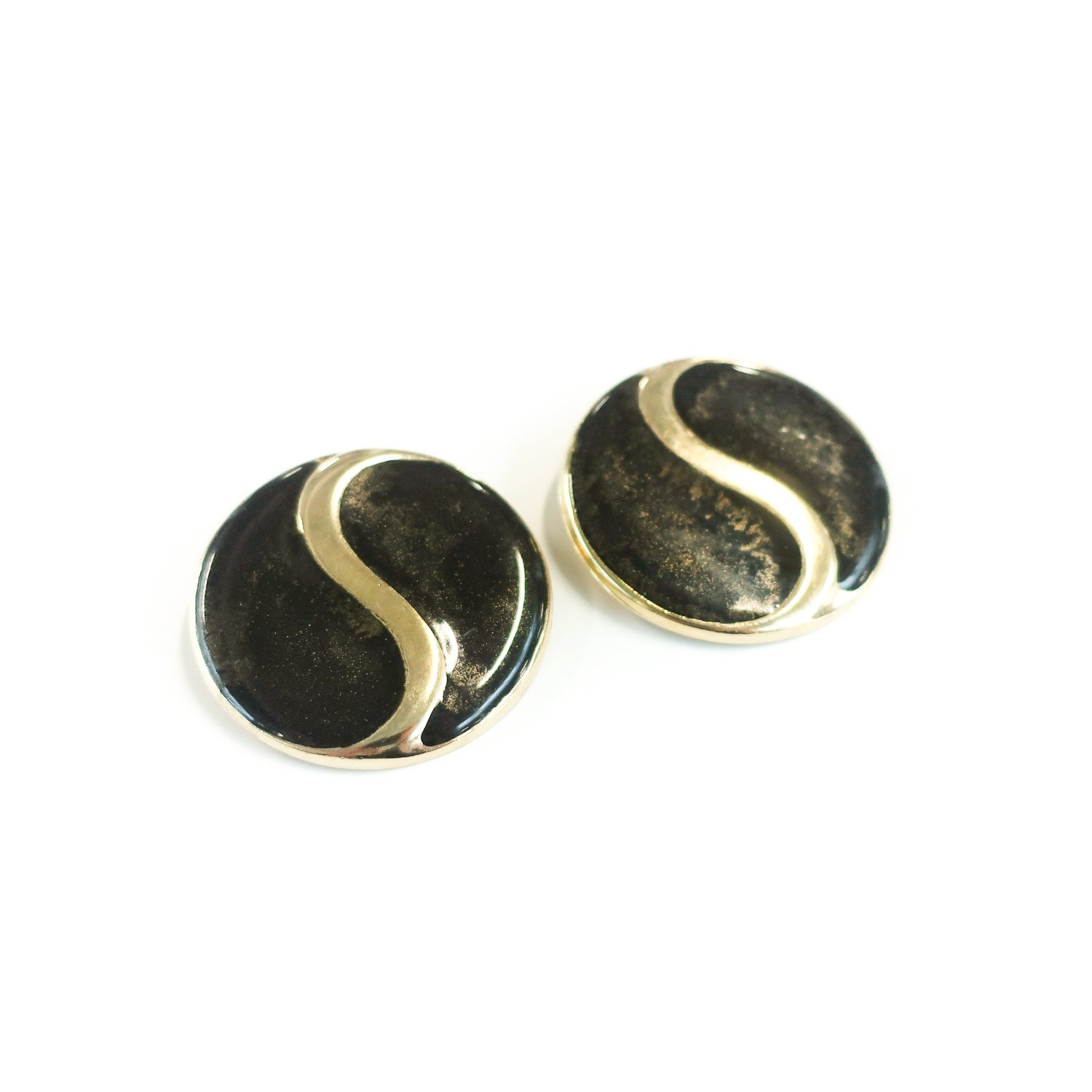 "Second Room Vintage Clothing. Vintage round, black and gold tone enamel painted earrings with yin yang design. Earrings are 1.75"" across. Original earring backs have been replaced with new, clear silicone backings. Free North American shipping on all orders."