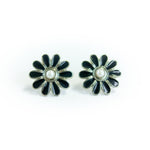 "Second Room Vintage Clothing. Vintage black and silver tone daisy stud earrings, with faux pearl center; 1"" across. Original earring backs have been replaced with new, clear silicone backings. Free North American shipping on all orders."