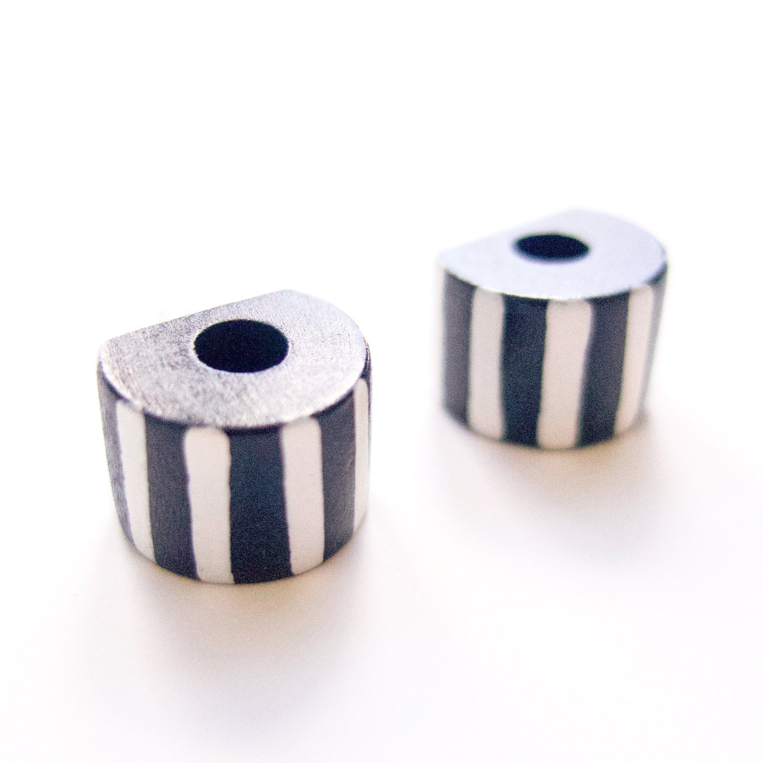 "Second Room Vintage Clothing. Vintage black and white painted stripe wood earrings, with a hole in the center. Earrings are 0.5"" all around. Free North American shipping on all orders."