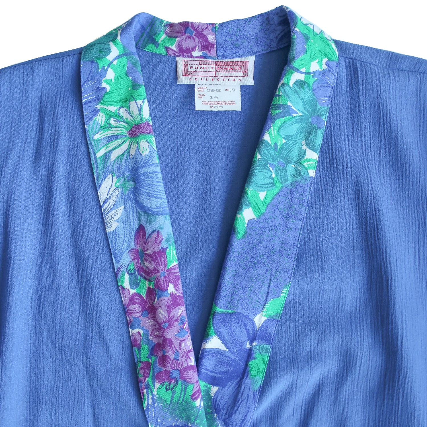 Second Room Vintage Clothing. Vintage blue blazer with floral print lining, which shows in the collar and the cuffs, when they are rolled up. Free North American shipping on all orders.